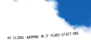 CFACT NY air banner no global warming 17 years
