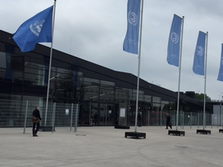 https://www.cfact.org/wp-content/uploads/2015/06/UN-Bonn-conference-center-flags.jpg